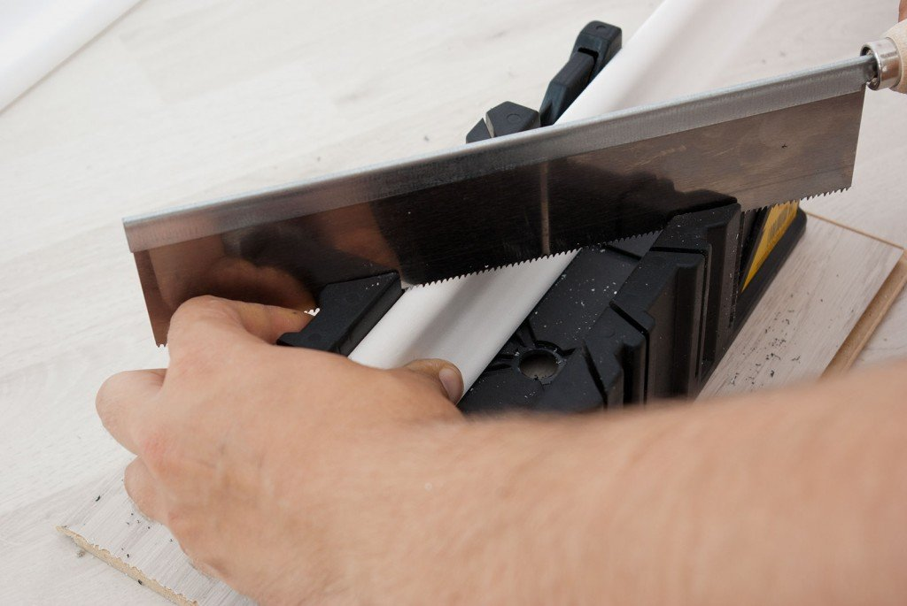Cutting baseboard with mitre box