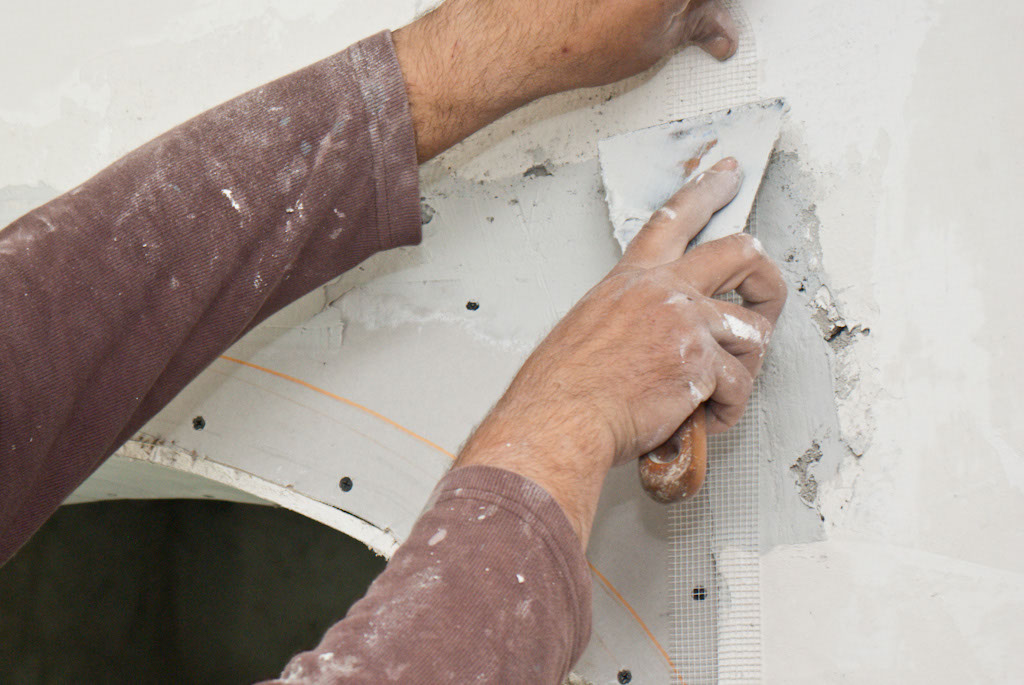 Applying paper tape on the drywall edges