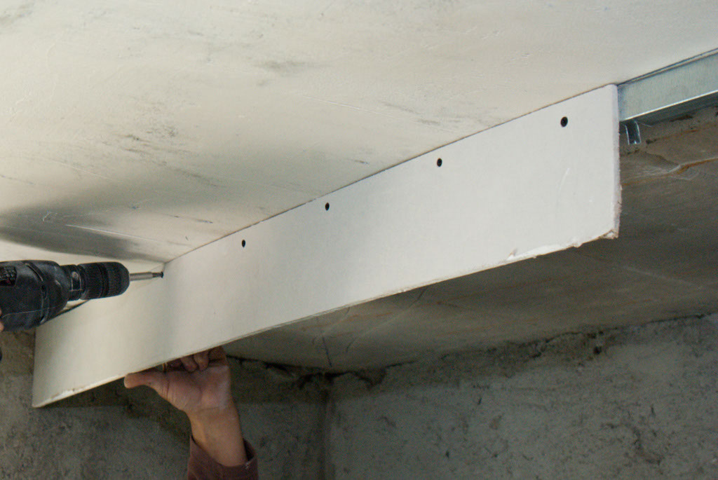 Fastening the drywall arch to the metal stud frame