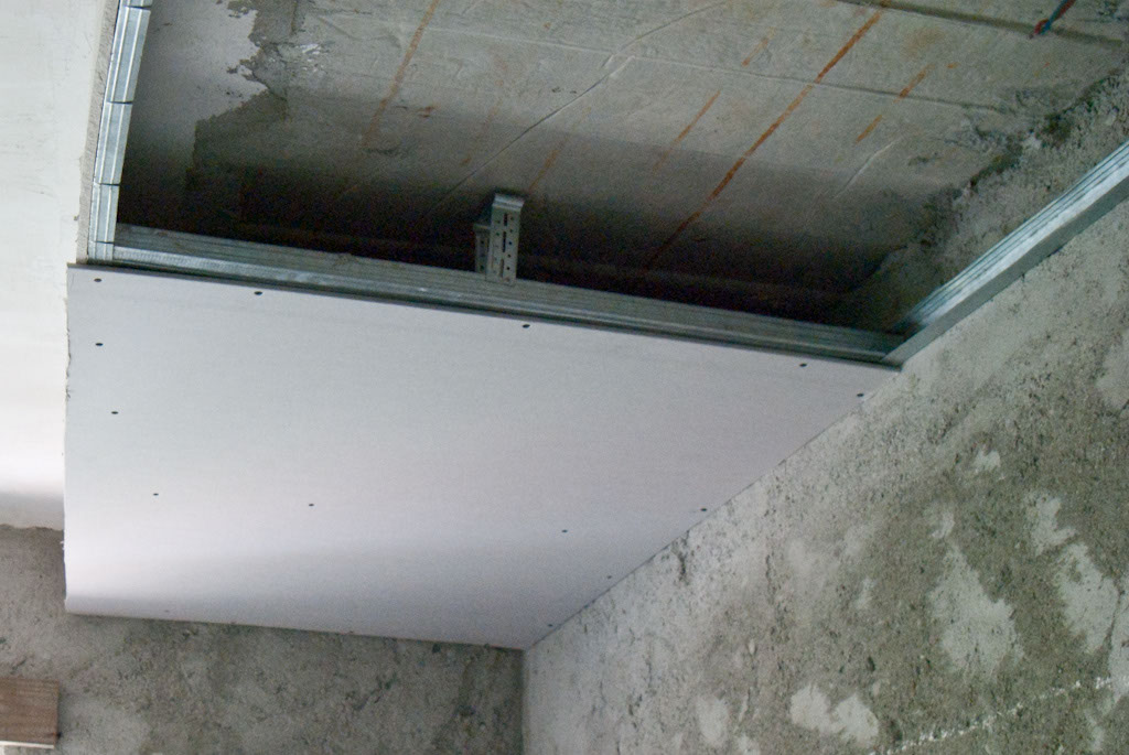 Fixing the drywall boards on the metal stud frame