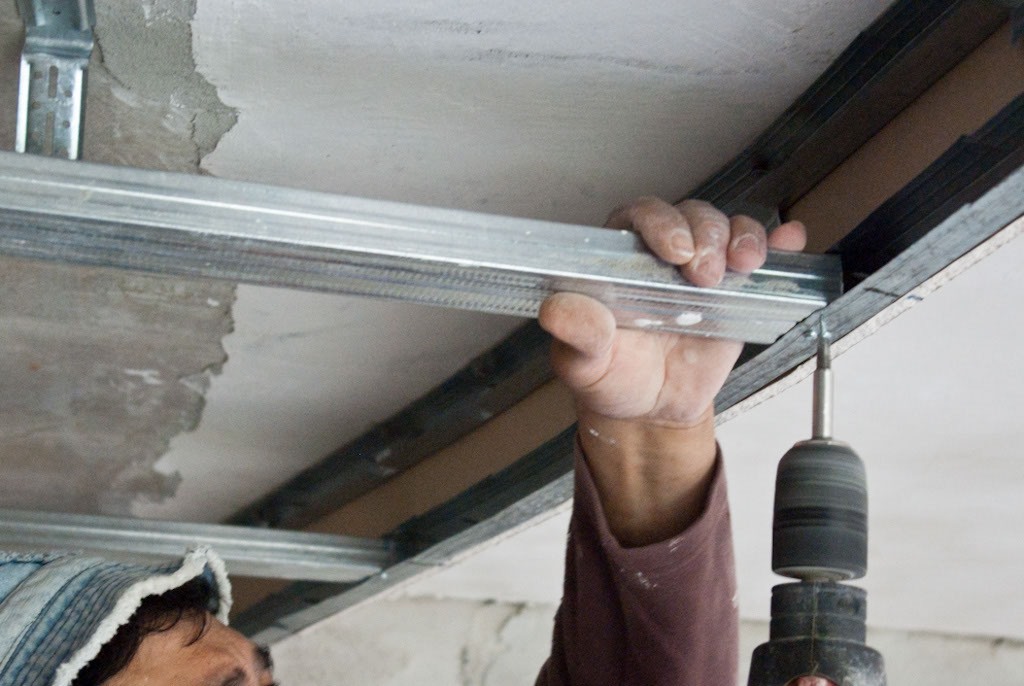 Installing ceiling arch metal stud frame