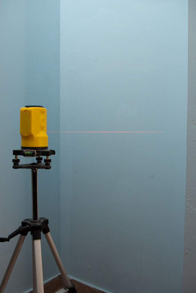 Using the laser level to install shelves
