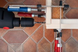 Drill machine clamps bedframe joint corner