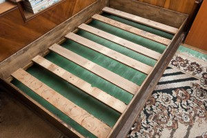 Installing the slats on a wooden bed frame