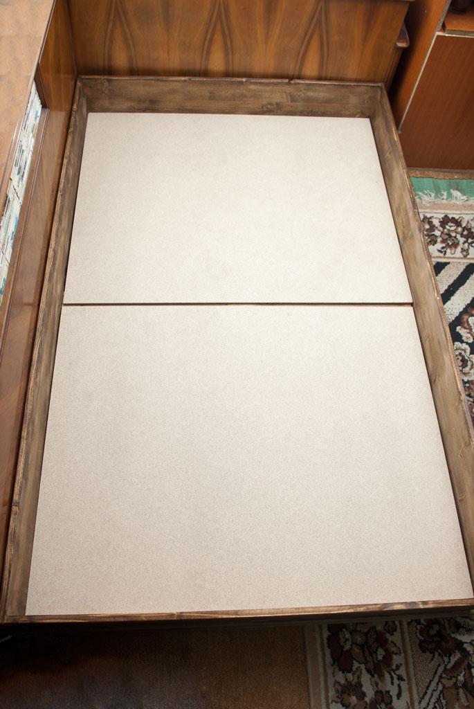 Installing plywood over bed frame's slats