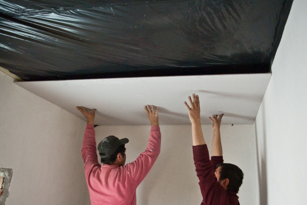 Installing drywall on ceiling