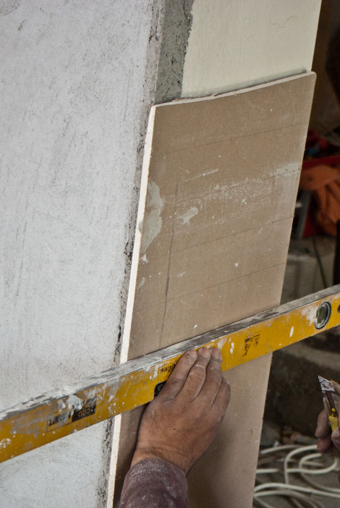Cutting the drywall to make it bend
