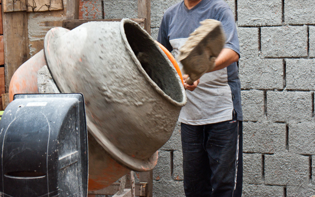 Mixing concrete with a power mixer
