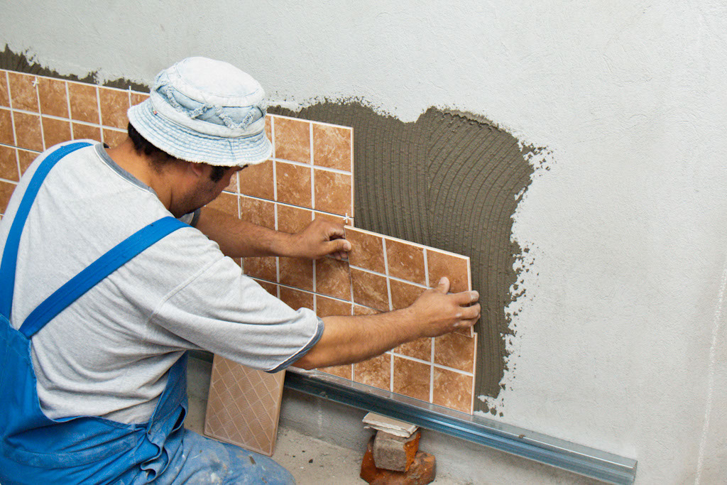 Installing tile spacers - How to install ceramic tile on wall ...