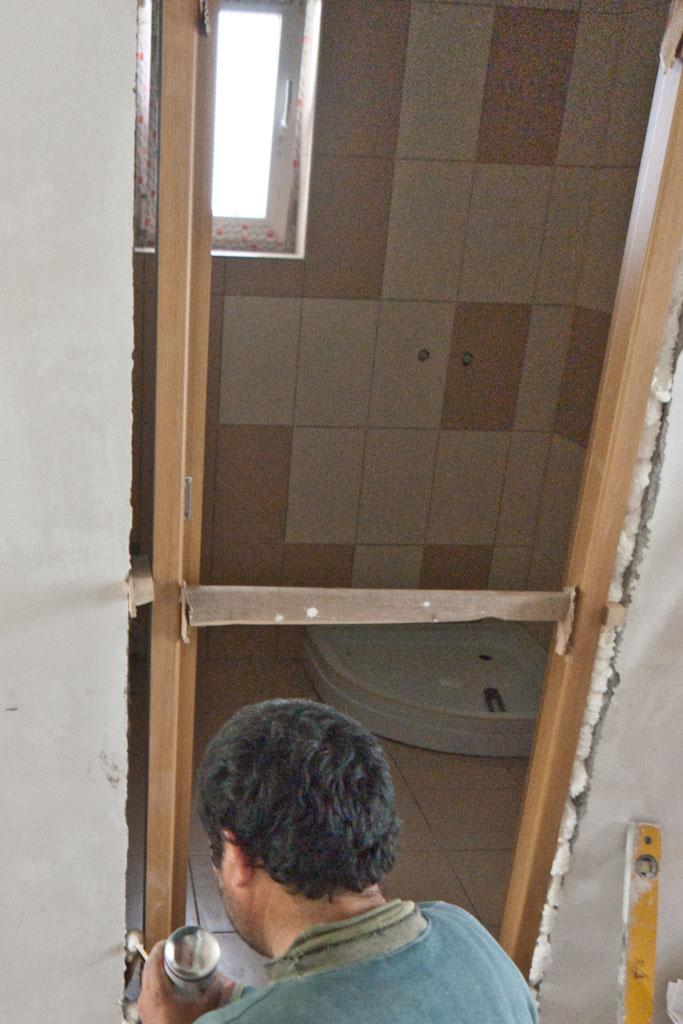 Fixing door into opening