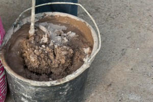 Using a drill mixer to prepare mud for polystyrene