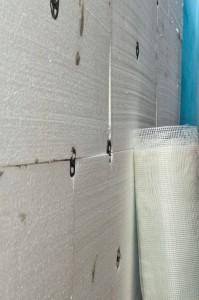 Installing fiberglass reinforcement net to polystyrene sheets