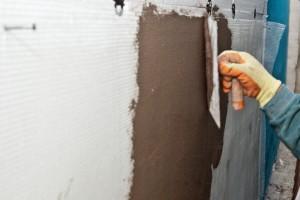 Installing fiberglass net over polystyrene