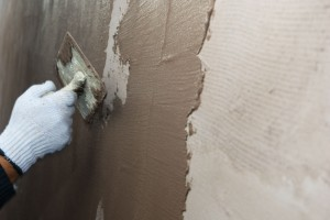 Applying putty to polystyrene sheets insulation