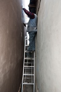 Using a folding ladder to finish polystyrene insulation