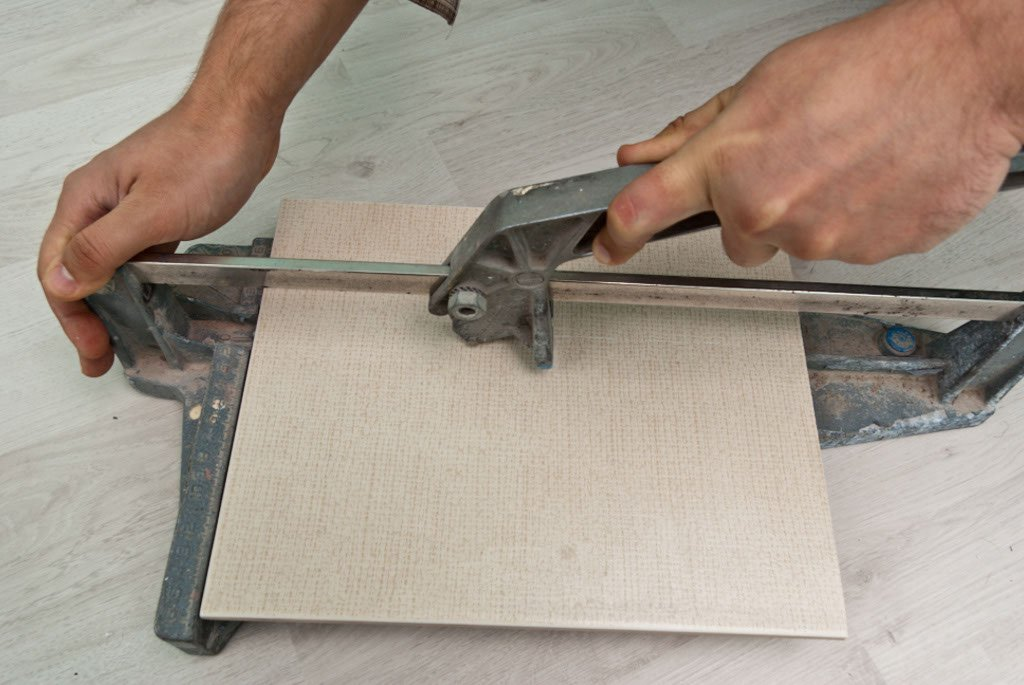 Cutting tiles with a tile cutter