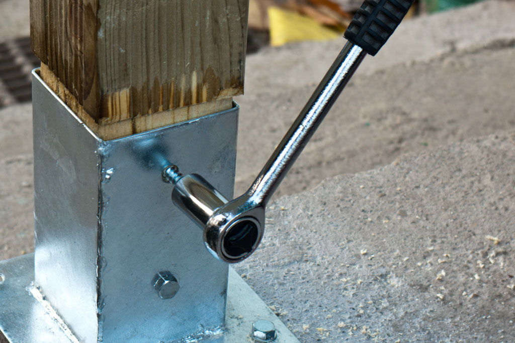 Using a wrench key to drive screws