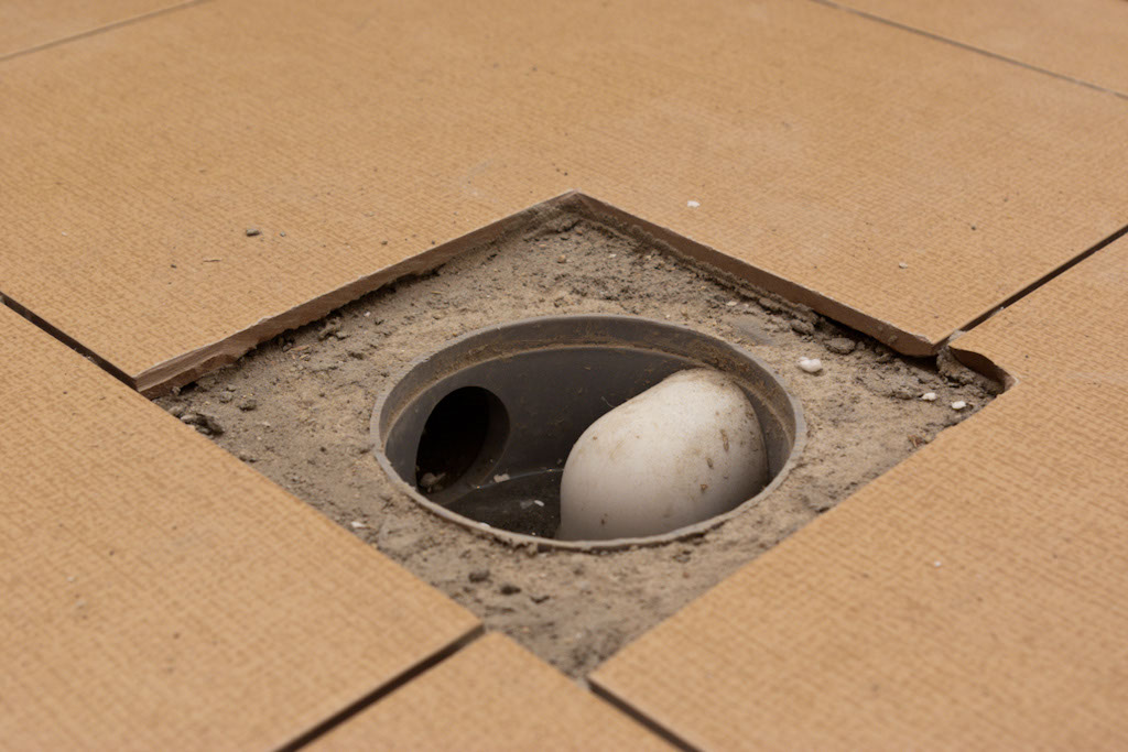 Installing tile around floor drain