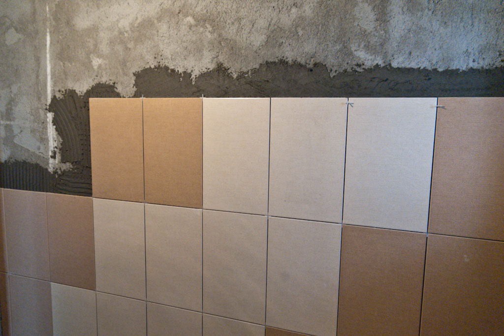 Installing wall tile in bathroom