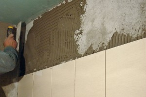 Installing last row of tile in bathroom