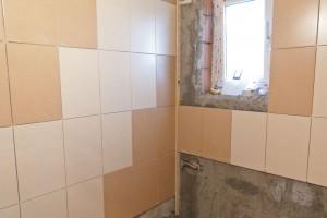 Installing tile around bathroom window