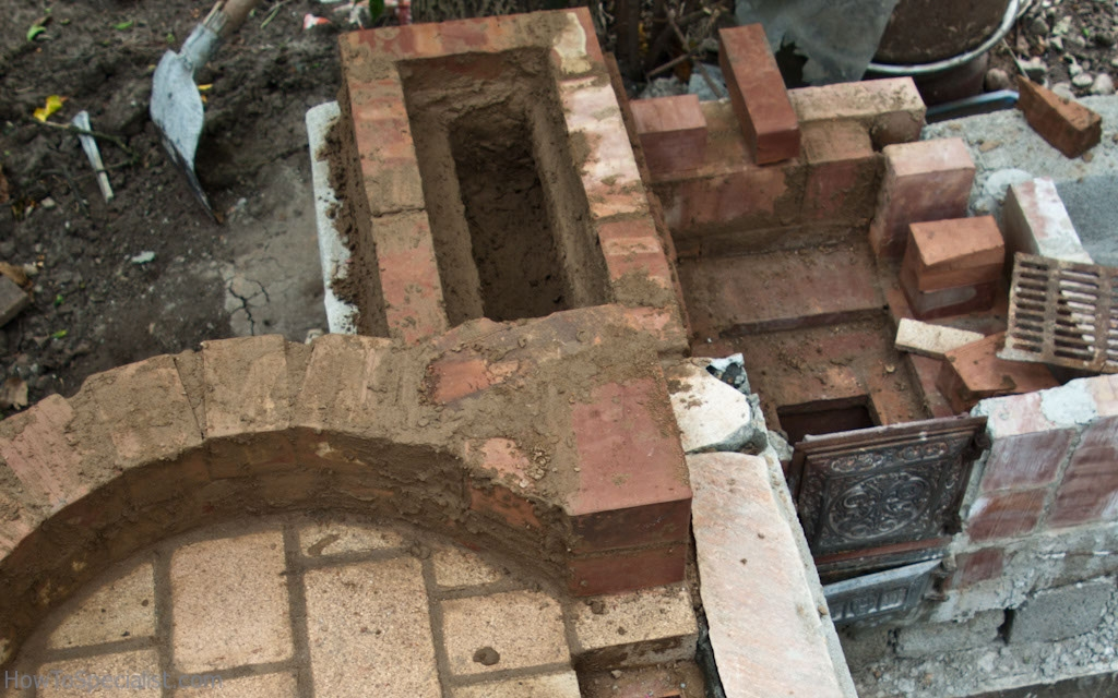 Constructing the chimney of the pizza oven
