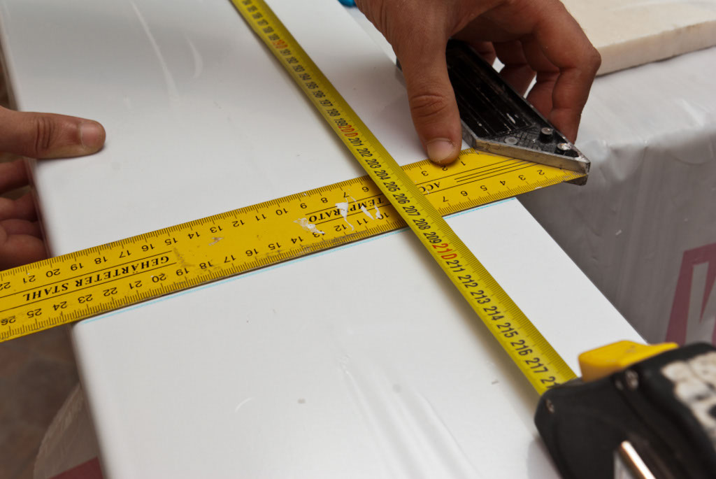 Using tape measurement and L-square to mark the cut