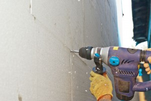 Drilling in concrete to fix polystyrene sheets