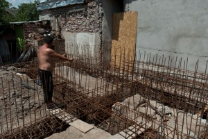Installing the rebar structure in the foundation trenches