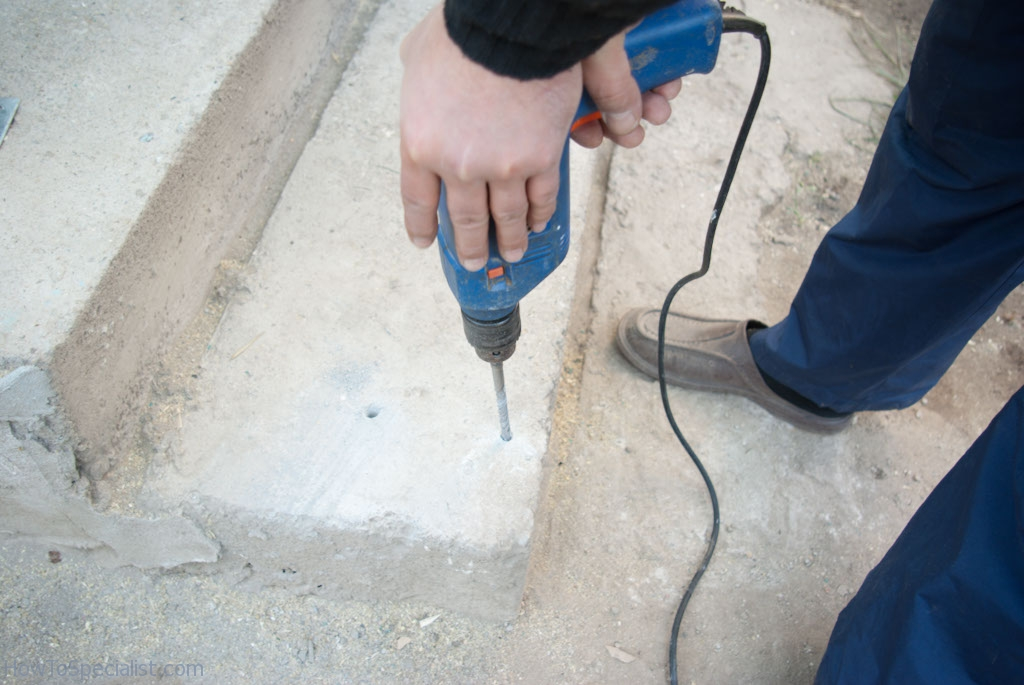 Drilling holes to anchor the post