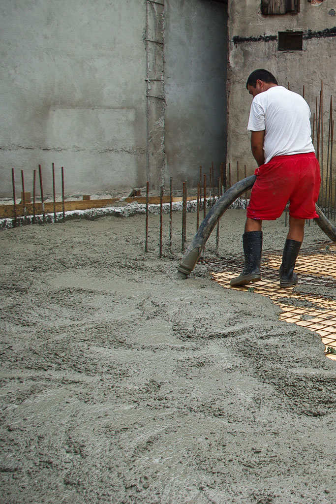 Pouring concrete with hose