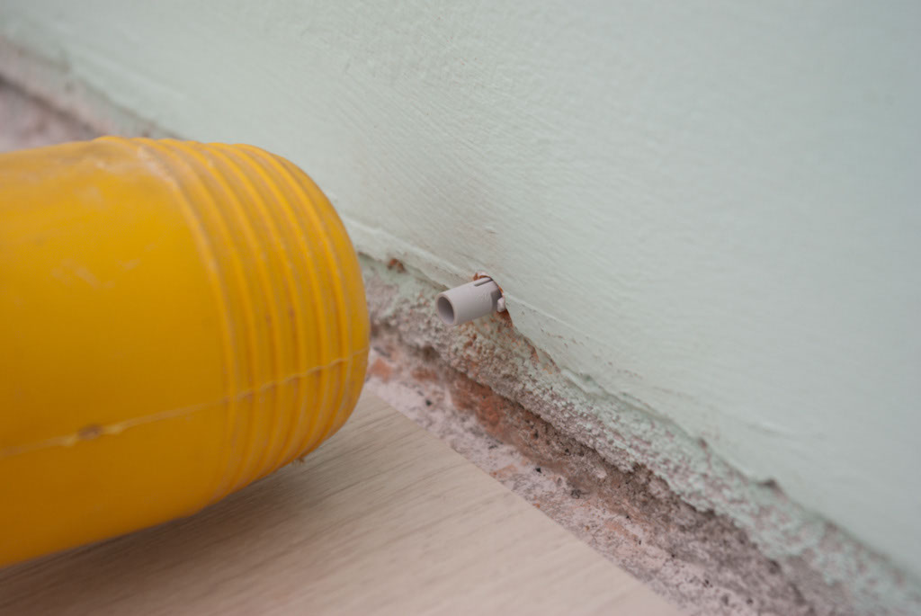 Inserting plastic anchors in wall