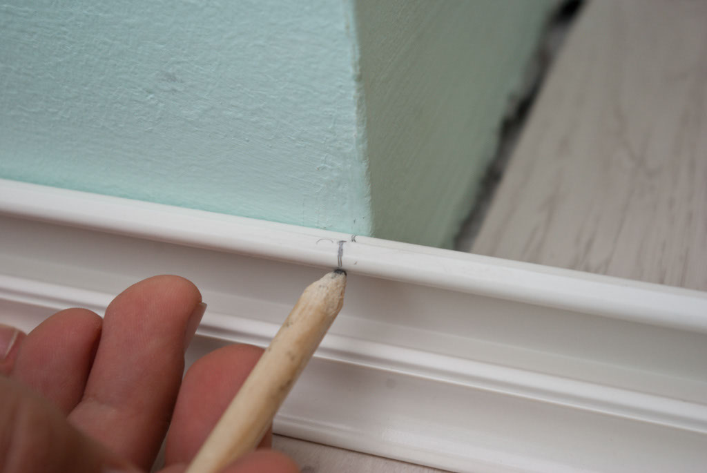 Marking the cut line on baseboard trim