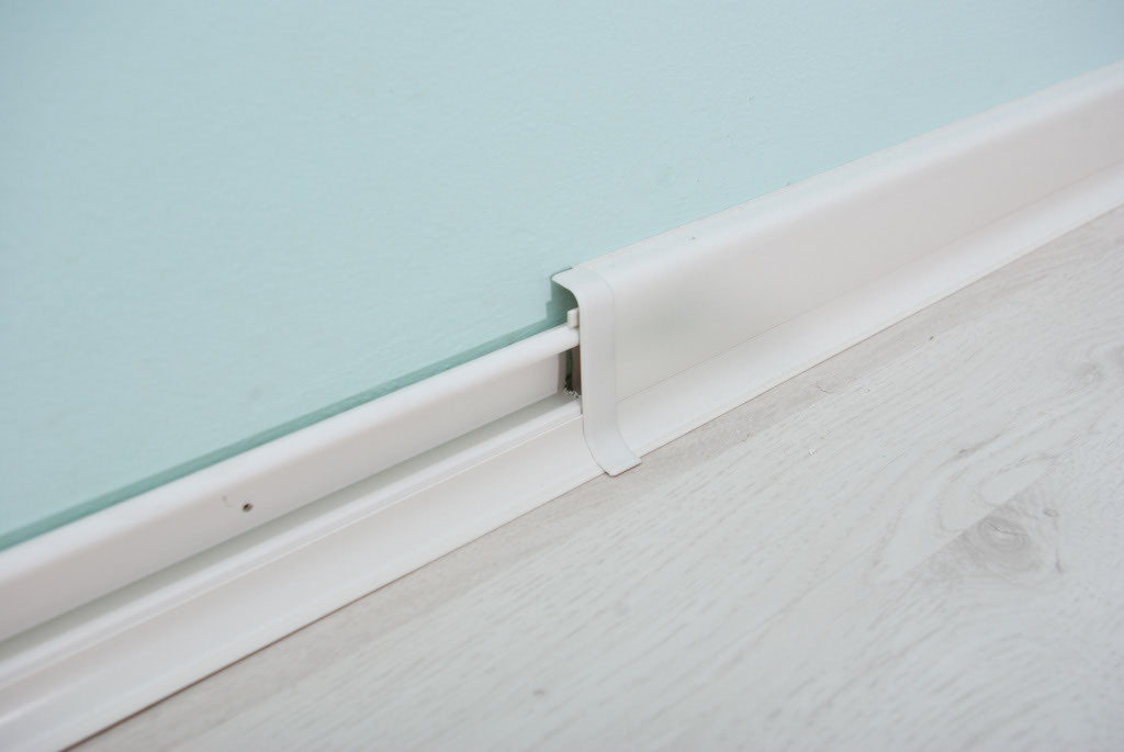 Pvc Wall Molding : How to install rubber baseboard howtospecialist