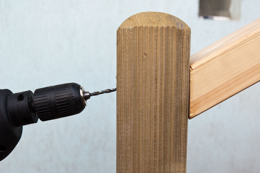 Drilling hole in deck post to fasten handrail