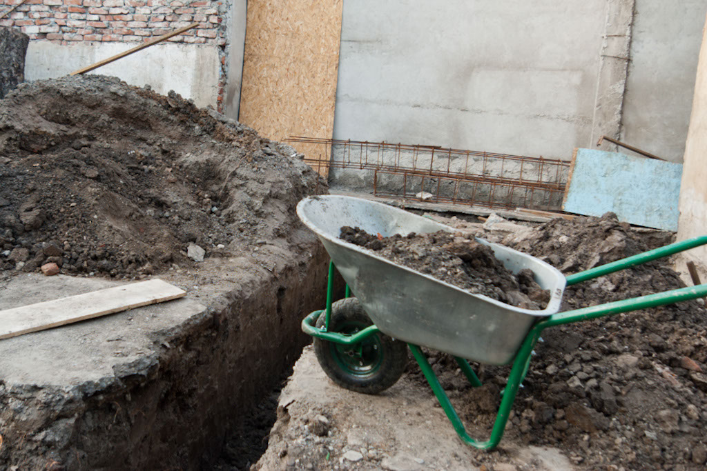 Moving earth with wheelbarrow