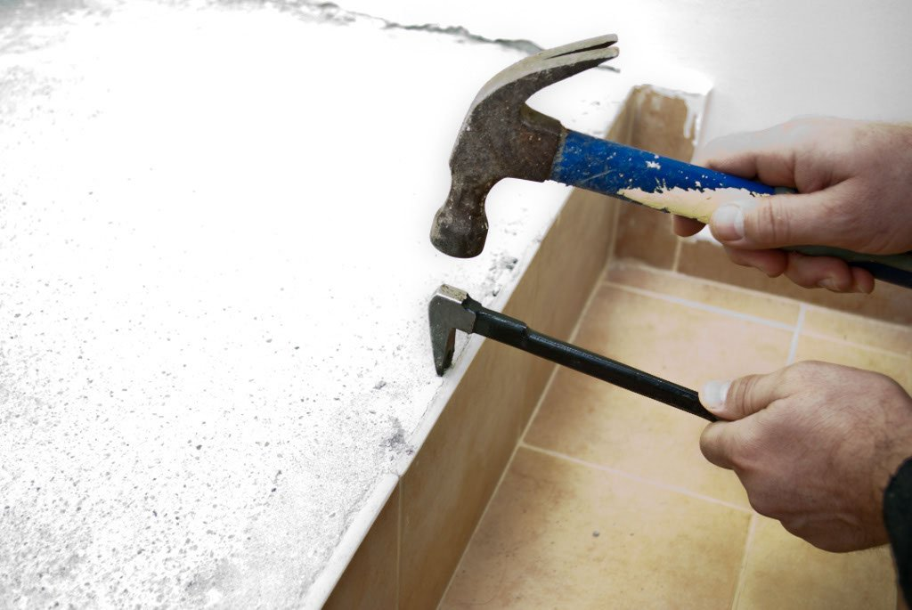 Using a chisel to remove wall tile