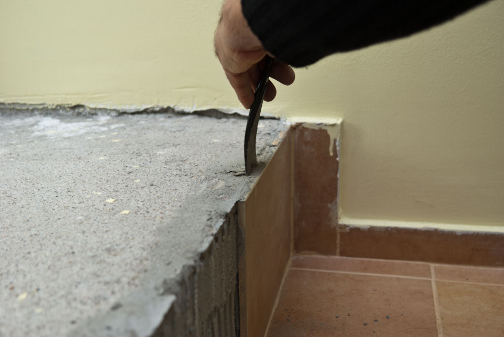Removing ceramic tile with a chisel