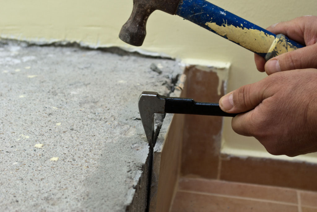 Tapping the chisel with a hammer