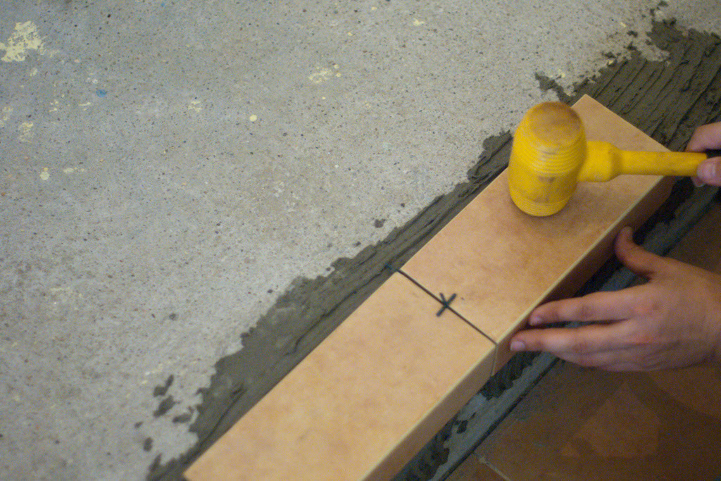 Tapping tile stairs
