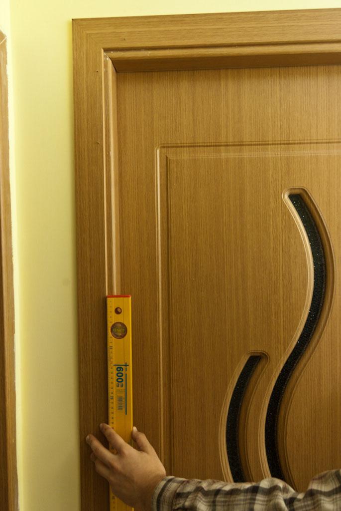 Making sure door casing is plumb