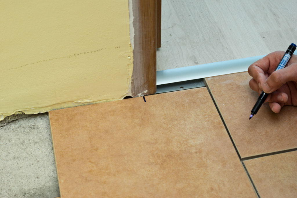 Marking tile around door jamb
