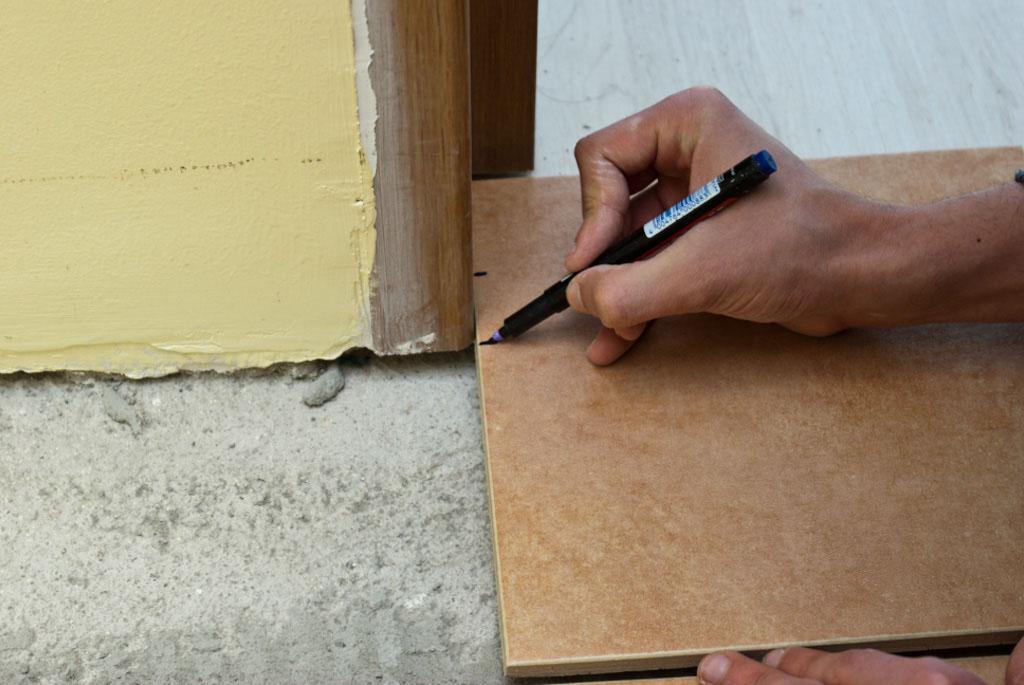 Measuring tile around door