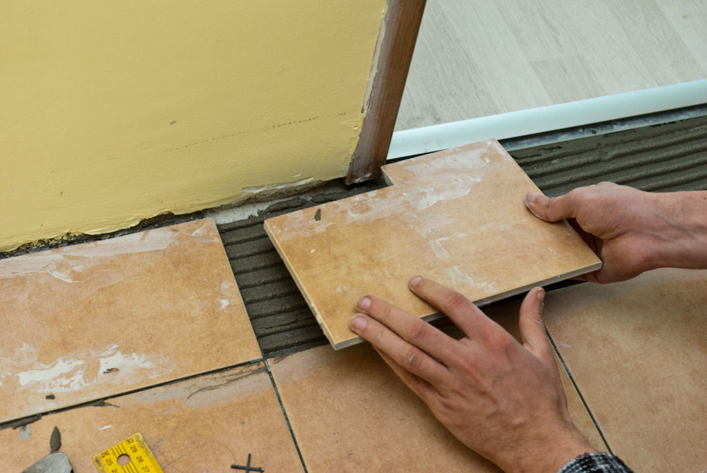 Installing tile around door jamb