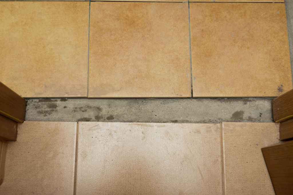 Installing transition from tile to tile