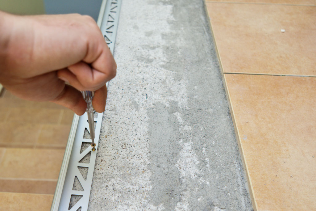 Securing metal tile edging with screws