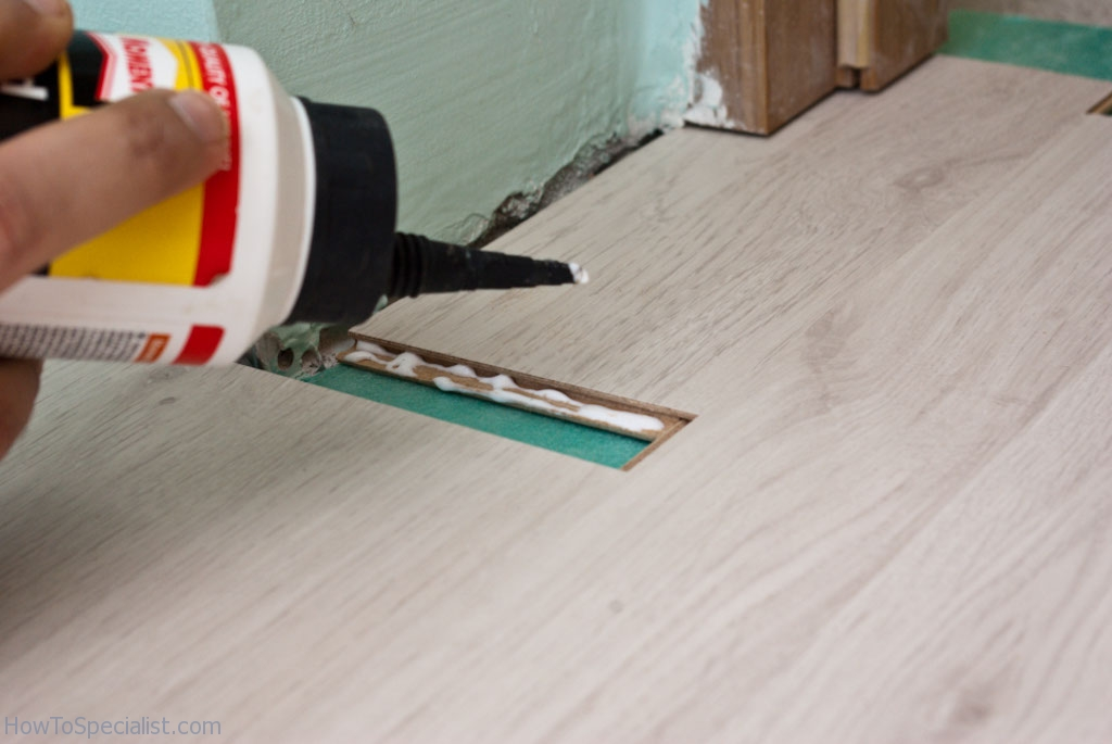 How to lay laminate flooring under door jamb