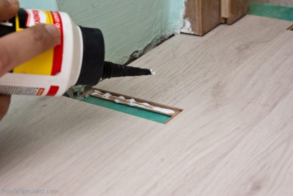 How to lay laminate flooring under door jamb