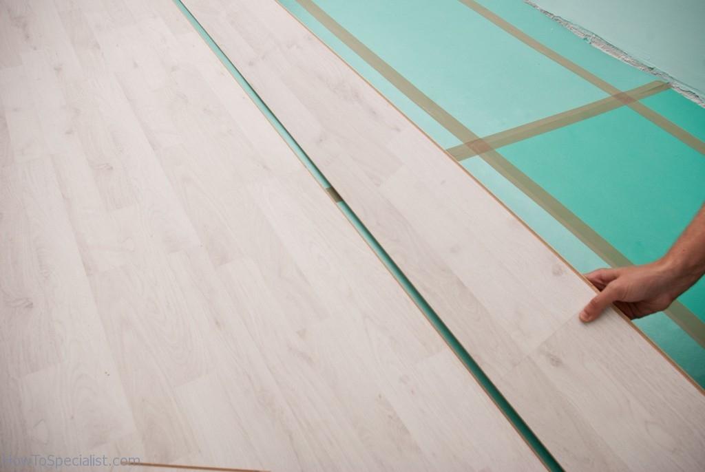 Connecting laminate flooring rows