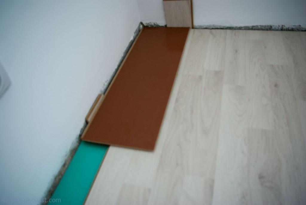 How to lay laminate flooring along wall